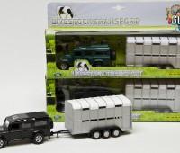 Zwarte Land Rover met Veetrailer 1