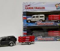 Land Rover defender met kano en trailer zilver 1