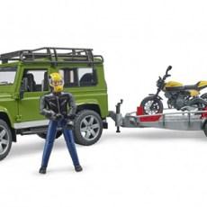 Land Rover en aanhanger met motor