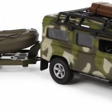Leger Land Rover met aanhanger en boot