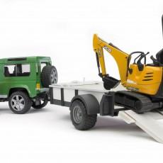 Land Rover met aanhanger en JCB minigraafmachine