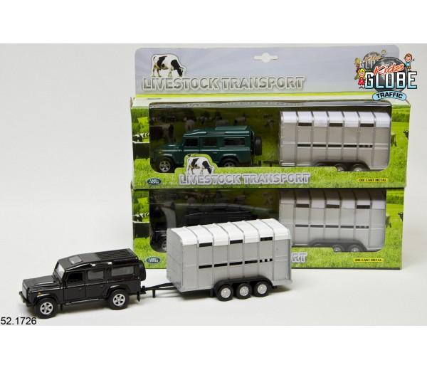 Zwarte Land Rover met Veetrailer