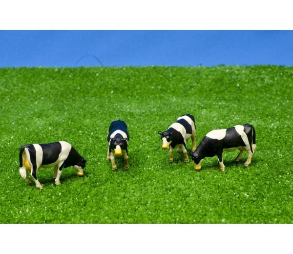 Set van 4 zwartbonte koeien