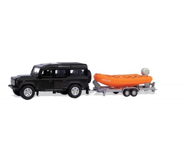 Zwarte Landrover Defender met reddingsboot en trailer