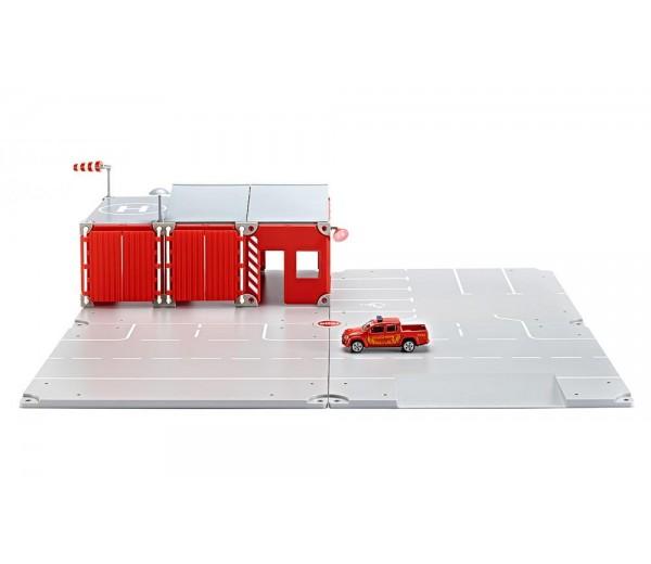 Grondplaten, brandweerkazerne en pickup truck